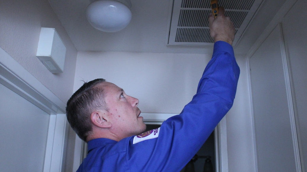 AHA employee Installing Air Conditioner